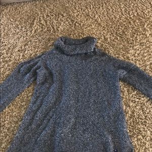 Turtle neck sweater with cutout shoulders